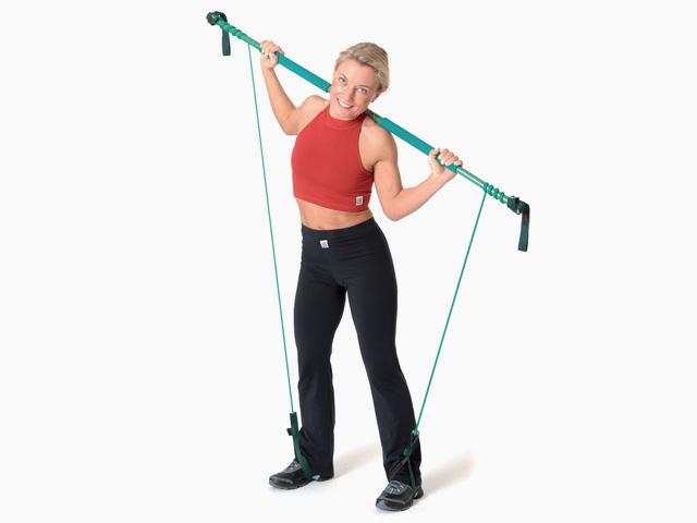 Frau in Endstellung der Übung Seitbeuge (Flexion) für den Gymstick