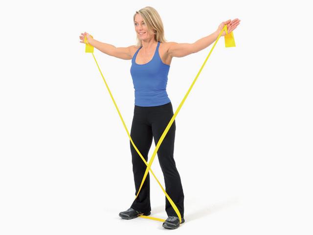 Frau in Variante der Übung Seitheben für das TheraBand
